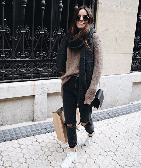 cute outfits with black ripped jeans and sweaters